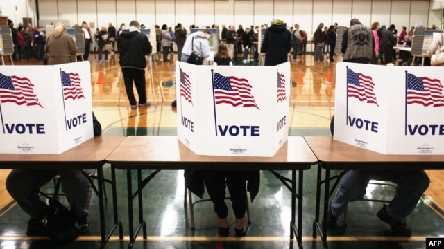 U.S. citizens vote in the presidential election at Carleton Middle School in Sterling Heights, Michigan.
