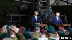 U.S. President Barack Obama (left) and Estonian Prime Minister Taavi Roivas speak to U.S. and Estonian troops at Tallinn Airport on September 3.