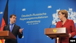 Russian President Dmitry Medvedev and German Chancellor Angela Merkel give a press conference after the plenary session of the German-Russian government talks in Yekaterinburg on July 15.
