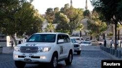 Експерти з хімічної зброї повертаються до готелю в Дамаску, Сирія, 3 жовтня 2013 року