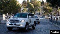 Джипы ООН с экспертами Организации по запрещению химического оружия в Дамаске, 3 октября 2013 года.