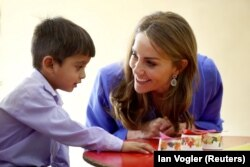 The duchess connects with a schoolboy in Islamabad.