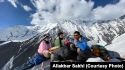 Some HikeVentures team members take a break after long hours of climbing the snow-peaked Hindu Kush Mountains in their ascent of Mount Noshaq.