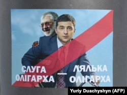 A placard depicting then-Ukrainian entertainer and presidential candidate Volodymyr Zelenskiy (right) and oligarch Ihor Kolomoyskiy in Lviv on February 8.