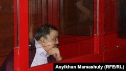 Ержан Утембаев на скамье подсудимых во время процесса, на котором пересматривался приговор в отношении него. Алматинская область, 22 января 2014 года.