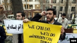 Iranian students stage a demonstration outside the UN office in Tehran in 2006 to protest one of the four rounds of international sanctions targeting Iran's nuclear activities.