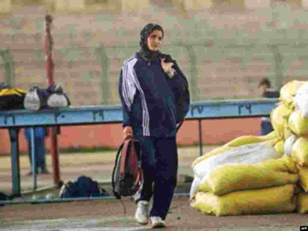 Afghan distance runner Mahbooba Ahadyar trains at Kabul Olympic Stadium in March 2008, one of only three athletes to compete for the country in the Beijing Games that year.