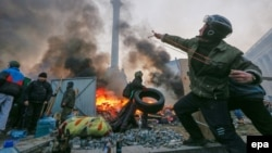 An antigovernment protester uses a catapult during clashes with riot police in downtown Kyiv on February 19. As the protests became increasingly heated, some of the language used in connection with them has been equally incendiary.