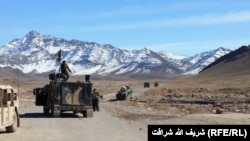 FILE: An Afghan army convoy in the southern province of Kandahar.