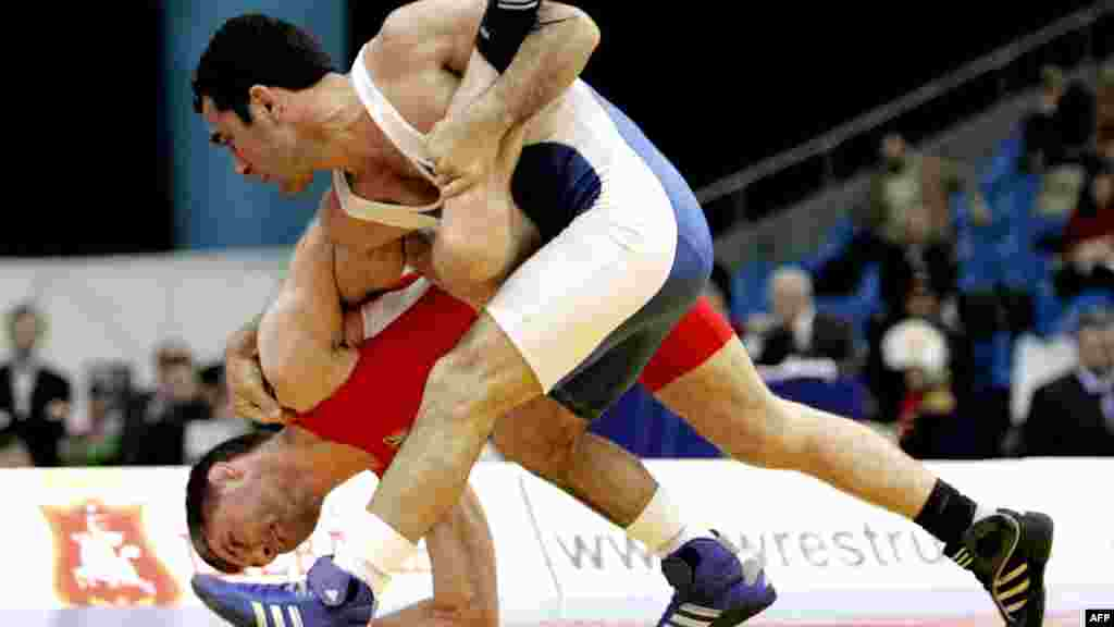 Azerbaijan has enjoyed success in other sports, however. Freestyle wrestler Namig Abdullayev (in blue and white) won his country's first Summer Games medal when he clinched silver in Atlanta in 1996. He also won gold four years later in Sydney.