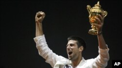 Novak Djokovic lifts the WImbledon men's singles trophy in Belgrade in July.