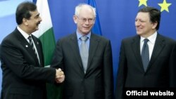 EU President Belgian Herman Van Rompuy (center) and Comission President Jose Manuel Barroso (right) greet Pakistani Prime Minister Yousaf Raza Gilani in Brussels.