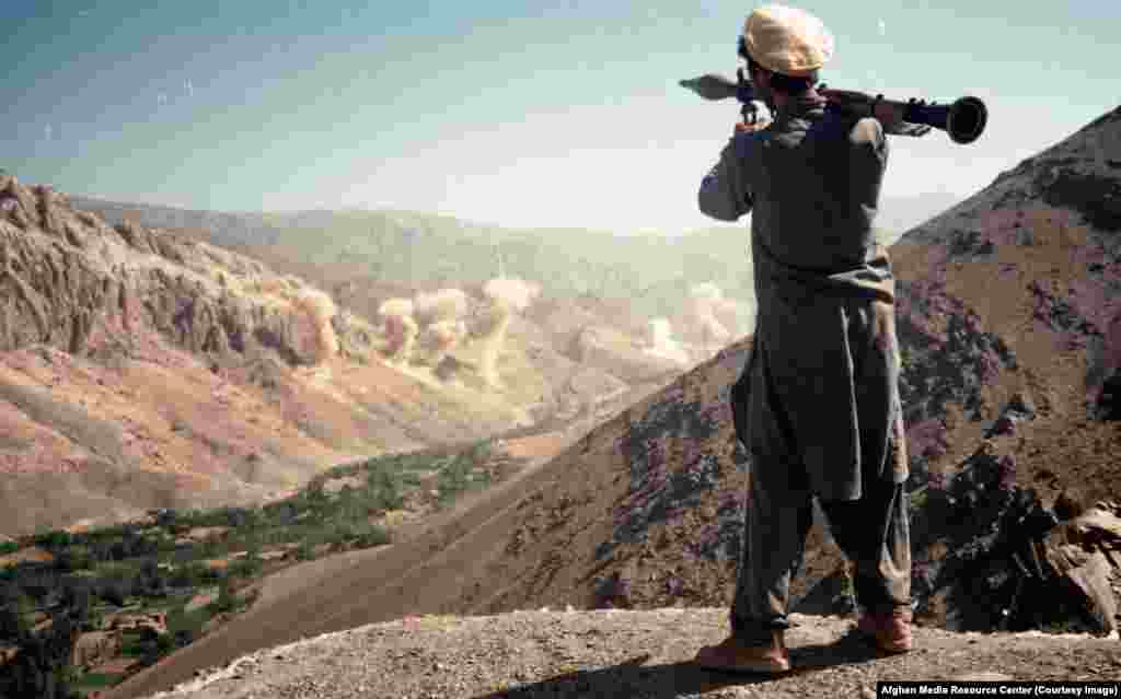 A fighter watches a Soviet bombardment hammer an Afghan valley. A bloody communist coup in Afghanistan in 1978 was followed a year later by a full-scale invasion by the U.S.S.R.