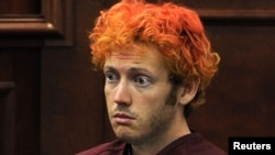 Colorado shooting suspect James Eagan Holmes makes his first court appearance in Aurora, Colorado, on July 23.
