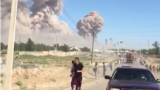 Kazakhstan - People trying to leave Arys on the background of a cloud of smoke from exploding ammunition. Turkestan region, 24Jun2019.