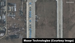 Russian Sukhoi Su-34 military aircraft are lined up at Russia's Morozovsk Air Base.