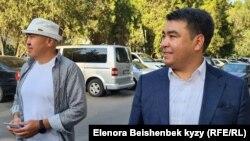 Депутаттар Алтынбек Сулайманов менен Жанар Акаев.
