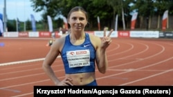 Sprinter Krystsina Tsimanouskaya flashes the victory sign during a track competition at a stadium in Szczecin, Poland, on August 15.
