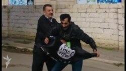 İŞİD bayraqdarı mitinqdə saxlandı