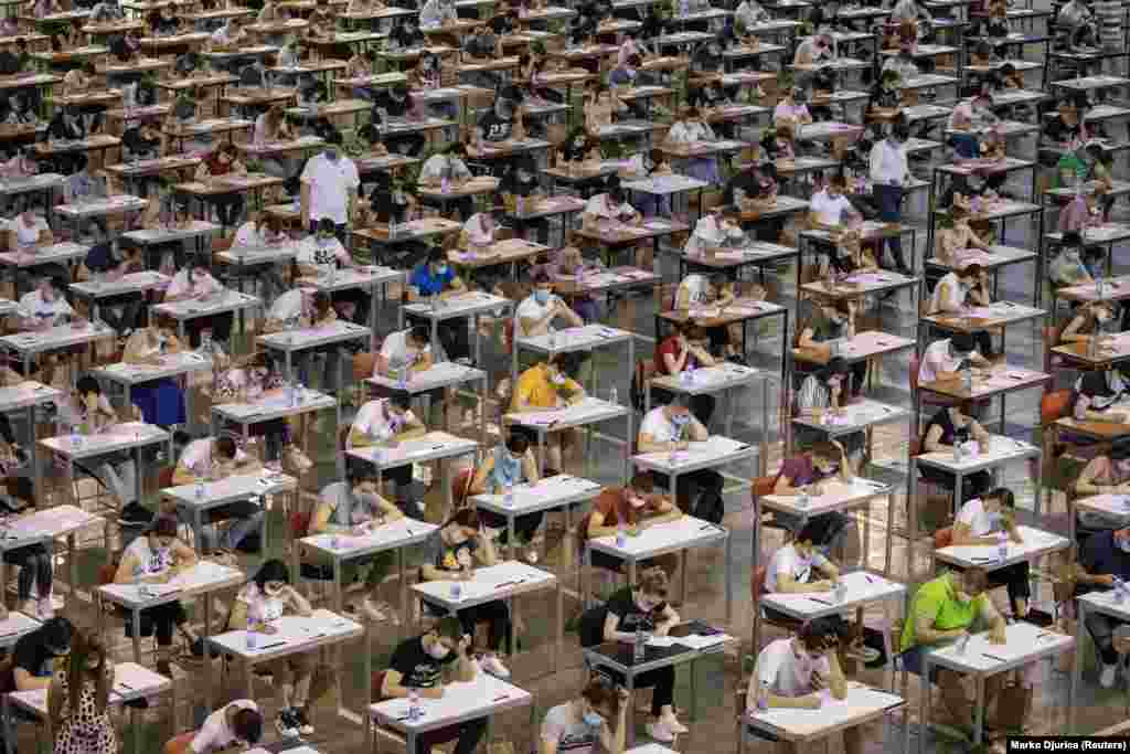 Students take a university entrance exam in Belgrade on June 30 amid a coronavirus outbreak in the Serbian capital. (Reuters/Marko Djurica)