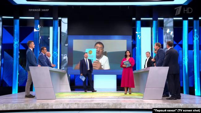 Обсуждение в передаче российского Первого канала видеозаписей Куата Ахметова