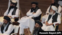 Taliban co-founder Mullah Abdul Ghani Baradar (bottom right) speaks at the opening session of peace talks between the Afghan government and the Taliban in Doha on September 12.