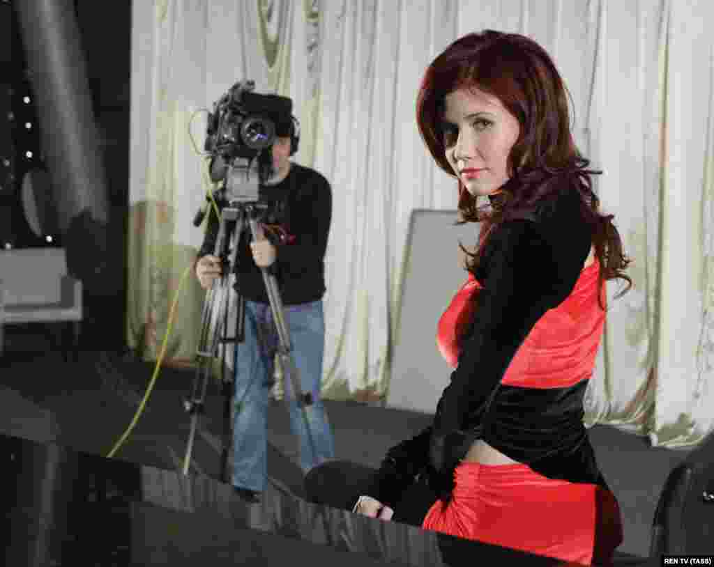 After returning to Russia, Chapman became a celebrity, TV host, and model. Here, she sits in a Moscow studio on January 13, 2011, as she hosts the television program Mysteries Of The World With Anna Chapman on Ren-TV.