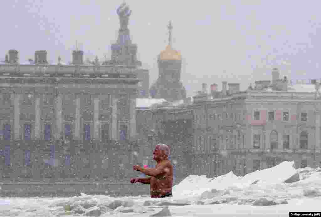 A man bathes in an ice hole in the Neva River in St. Petersburg, Russia. The temperature in St. Petersburg is minus 15 Celsius. (AP/Dmitri Lovetsky)