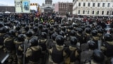 Police block protesters during a rally in support of jailed opposition leader Aleksei Navalny in St. Petersburg on January 31.