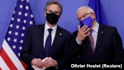 U.S. Secretary of State Antony Blinken (left) with European Union foreign policy chief Josep Borrell ahead of meetings in Brussels on March 24