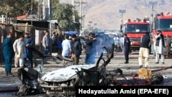 Afghan security forces inspect the site of a blast in Kabul on October 27.