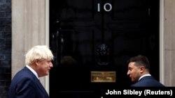 British Prime Minister Boris Johnson (left) meets Ukrainian President Volodymyr Zelenskiy at Downing Street on October 8.
