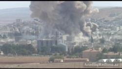 Kobanidə yaraqlılar bombalanarkən çəkilən video