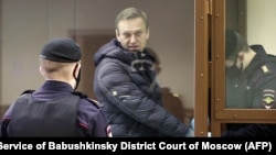 Already in prison on embezzlement charges he says were trumped up, Kremlin foe Aleksei Navalny could soon feel the full-force of Russia's anti-extremism law. (file photo)