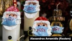 Илустрација: Божиќни свеќички со маски во Грција