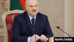 Alyaksandr Lukashenka attends a meeting with governors of Russia's Leningrad and Irkutsk regions in Minsk on September 25.