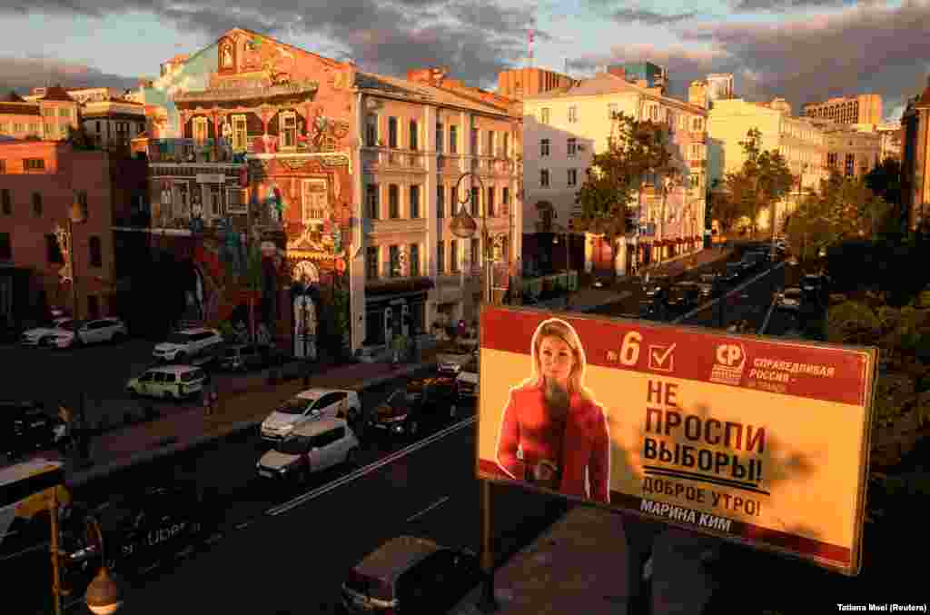 A campaign poster for the A Just Russia -- For Truth party candidate for the upcoming parliamentary elections is seen at sunset in Vladivostok, Russia.