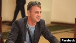 His lawyer says Igor Khoroshilov has the right to immunity during the election season as a member of the election committee, and that he was illegally denied access after his client's arrest.