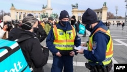 Police were seen checking the documentation of those attending the Budapest rally on January 31.