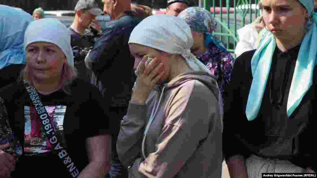 Victims' families react during the students' funeral.