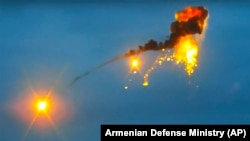 NAGORNO KARABAKH -- This image taken from video released by the Armenian Defense Ministry on Thursday, Oct. 1, 2020 allegedly shows the shooting down of an Azerbaijani unmanned aerial vehicle by a rocket.