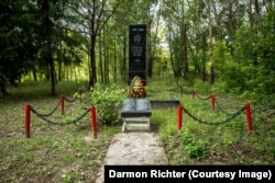 """Zherdnaye, Belarus. The inscription on the black granite memorial reads """"1941-1945. The grateful homeland will forever be proud of the heroic deeds of its brave sons and daughters."""""""
