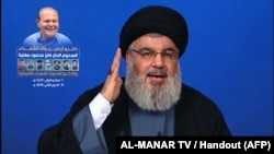 An image grab taken from Hezbollah's al-Manar TV on January 19, 2018 shows Hassan Nasrallah, the head of Lebanon's militant Shiite movement Hezbollah, giving a televised address from an undisclosed location in Lebanon.