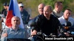 Russian President Vladimir Putin drives a motorcycle during a bike show outside Sevastopol, Crimea, on August 10.