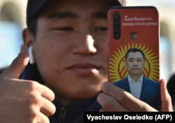 A supporter of Kyrgyz President-elect Sadyr Japarov attends a rally on Ala-Too Square in Bishkek on January 11.