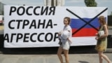 A sign is seen in Mariupol on the occasion of the fourth anniversary of the city's liberation from pro-Russia forces on June 16.