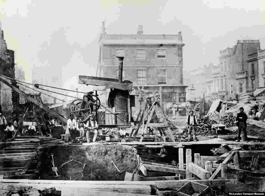 "In this undated photo, workers extend the rail line using ""cut and cover"" construction, digging deep below the surface of London's Praed Street."