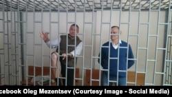 Станіслав Клих (зліва) та Микола Карпюк на суді в Грозному, Росія