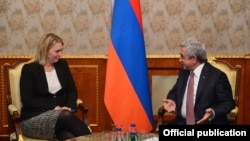 Armenian President Serzh Sarkisian (right) meets with Bridget Brink, the U.S. deputy assistant secretary of state for European and Eurasian affairs, in Yerevan on November 16.