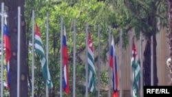 Russian and Abkhaz flags flying in front of Abkhazia's government headquarters in Sukhumi.